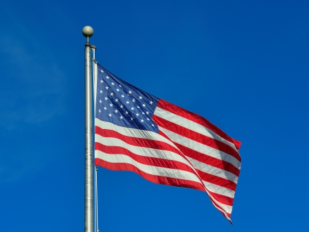 American flag fluttering on a clear day