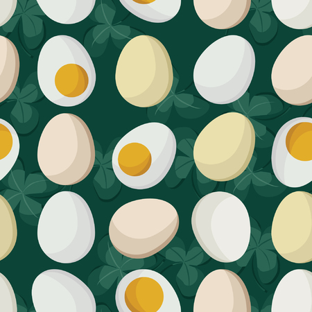 Hard boiled eggs on green clover background.