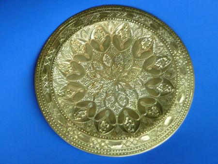 plate: Ornate Imported Brass Decorative Wall Plate Hanging Stock Photo