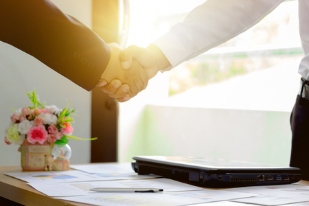 Business man Handshaking, About with working, Happy with success Agreed to work, Handshake Business Marketing in graph Concept. Stock Photo