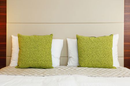 hotel bedroom with green pillow photo