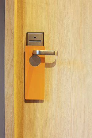 hotel door: hotel door with orange card to avoid disturbing
