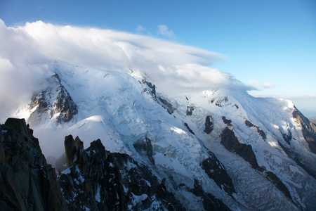 The mont blanc from Aiguille du Midi, the peak within the clouds  photo