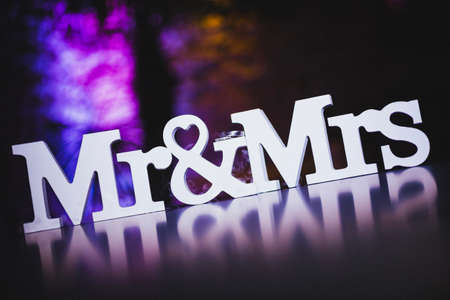mr & mrs sign on reflecting table with stylish background color Imagens