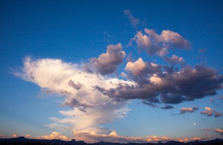 White Fluffy Clouds, Blue Sky over Mojave Desert Stock Photo