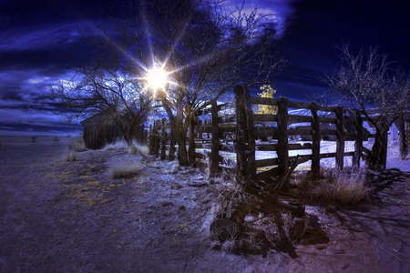 sonora: Infrared False Color Sun Flare and Wooden Fence Stock Photo