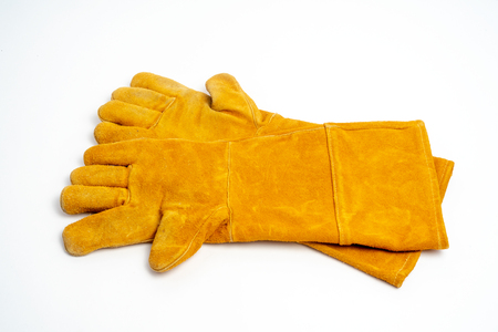 Long leather glove for welding industrial ,fire protection type ,isolated on white background. Stock Photo