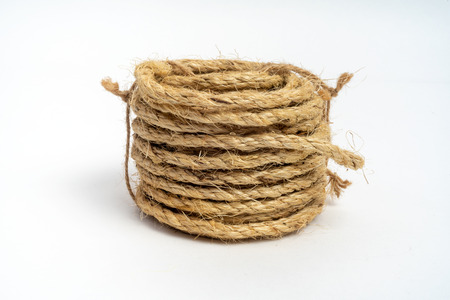 Coil of fiber rope sisal small on isolated white background Stock Photo