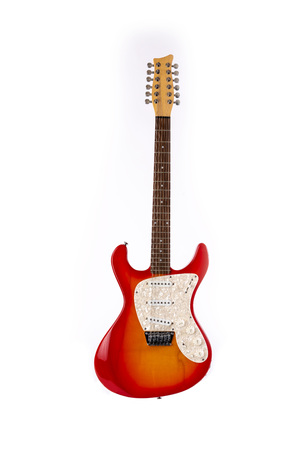 classic musical instrument wooden six-string guitar red isolated on white background Фото со стока