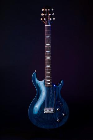 Electric Guitar, dark blue woodgrain, 6 String isolated on black