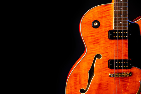 Vintage Electric Guitar, Orange flame maple, 6 String isolated on black Фото со стока