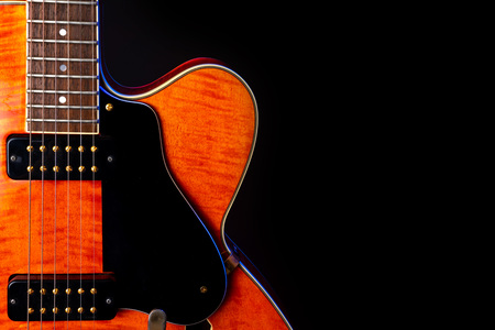 Vintage Electric Guitar, Orange flame maple, 6 String isolated on black 免版税图像