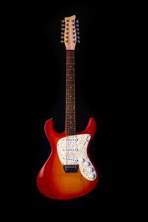 musical instrument wooden six-string guitar red isolated on blackbackground 免版税图像 - 125226071