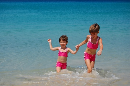 Two little girls on the beach photo