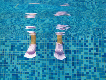 Underwater childs legs photo