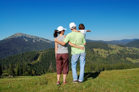 Family of three on their vacation in mountains Stock Photo - 9337211