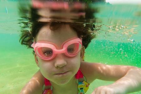 Kid swimming underwater  photo