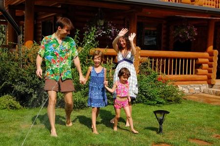 Happy family having fun in the garden photo