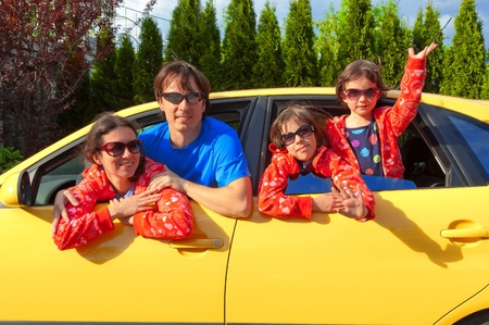 Family vacation. Parents with two kids having car trip Stock Photo