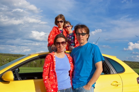 Family vacation. Parents with two kids having car trip photo