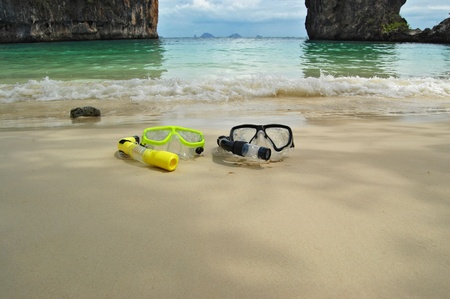 Two snorkels on tropical beach photo