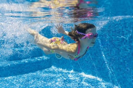 Underwater kid in swimming pool Stock Photo - 9680128