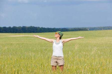 Happy woman in field photo