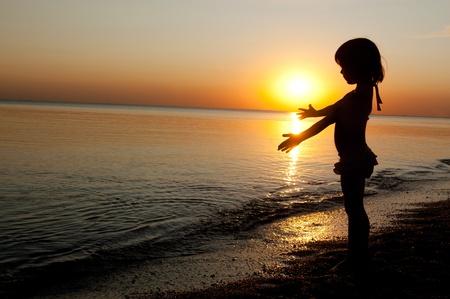 Child on sunset beach Stock Photo - 10109250
