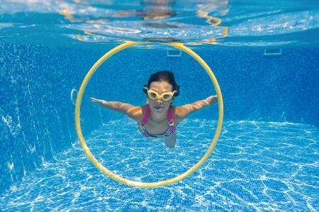 Underwater kid in swimming pool photo