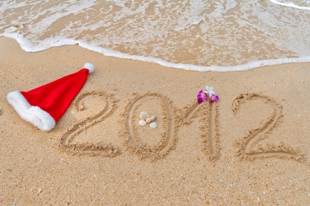 Numbers 2012 on tropical beach sand - holiday background Stock Photo - 10531945