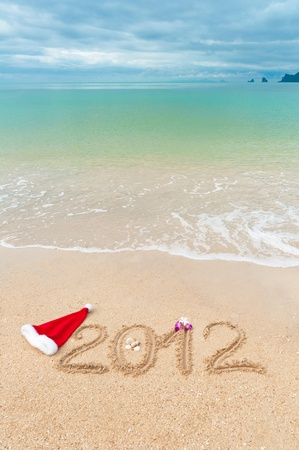 Numbers 2012 on tropical beach sand - vertical holiday background Stock Photo - 10531942