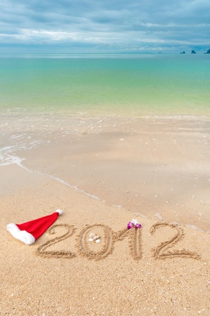 Numbers 2012 on tropical beach sand - vertical holiday background Stock Photo - 10597205