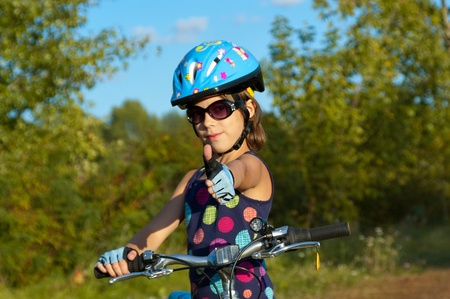 bicycle helmet: Happy girl cycling outdoors. Smiling child on bicycle Stock Photo