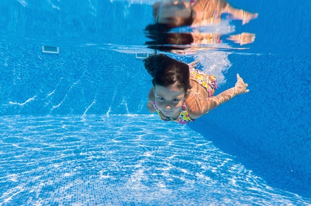 Underwater kid in swimming pool photo