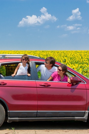 Family vacation. Parents with child in car trip. Vertical image photo