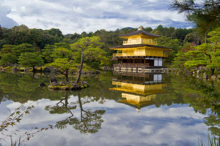 Golden temple near beautiful lake, Japan