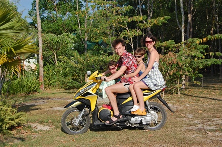 woman motorcycle: Family of four on motorbike