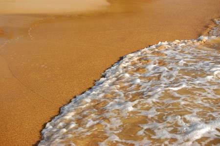 Background of wave on sand. Beach vacation concept Stock Photo - 12600652