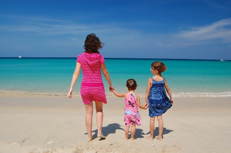 Family beach vacation  Happy mother with kids having fun near sea  Summer vacation with children  photo