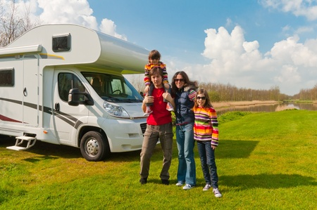 Family vacation in camping  Happy active parents with kids travel on camper  Family having fun near their motorhome  Spring vacation trip with children  photo