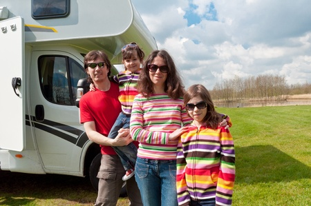 Family vacation in camping  Happy active parents with kids travel on camper  Family having fun near their motorhome  Spring vacation trip with children Stock Photo - 13346910