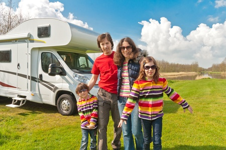 motorhome: Family vacation in camping  Happy active parents with kids travel on camper  RV   Family having fun near their motorhome  Spring vacation trip with children