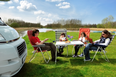 Family vacation in camping  Happy active parents with kids travel on camper  RV   Family having fun  and relaxing near their motorhome  Spring holiday trip with children  Reklamní fotografie