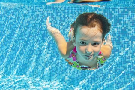 Happy smiling underwater child in swimming pool  Reklamní fotografie