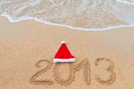 New year 2013 and Christmas beach vacation and holiday concept  2013 written on tropical beach sand Stock Photo - 15481405