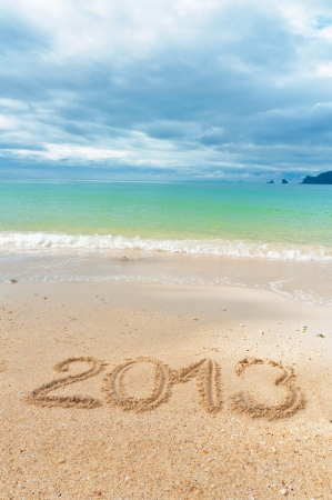 New year 2013 and Christmas beach vacation and holiday concept  2013 written on tropical beach sand, vertical image Stock Photo - 15481404