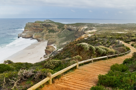 cape of good hope: Wooden path with beautiful sea view. Cliffs and ocean at Cape of Good Hope, South Africa Stock Photo