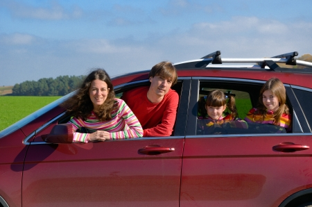 Family car trip on vacation, happy parents travel with kids and having fun  Car insurance and holiday concept Stock Photo