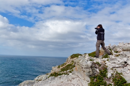 Photographer making picture of beautiful Dias beach and nature, Cape of Good Hope, South Africa photo