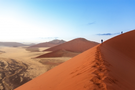 sossusvlei: People walking on beautiful sunrise dunes of Namib desert, Sossusvlei, Namibia, South Africa Stock Photo